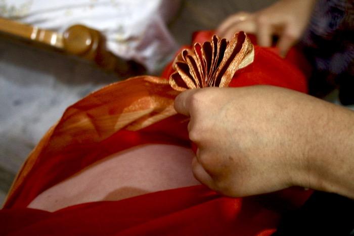 Faltung des Saris